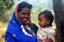 AN ADIVASI WOMAN  AND   CHILD